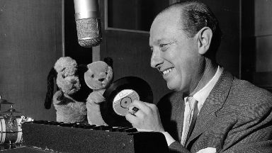 Auction: Harry Corbett with his puppets Sooty and Sweep.