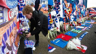 Tribute: Fans have been leaving flowers, flags, scarves and strips.
