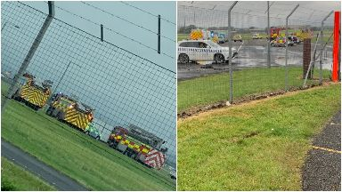 Evacuation: Emergency services were seen on the runway.
