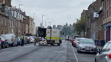 Bomb squad: Emergency services closed the road.