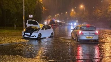 Cars struggled through the water in the north east.
