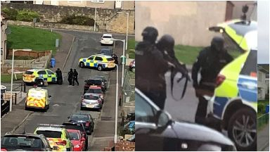 Armed police and negotiators at the scene.