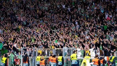Celtic fans celebrate their last-minute win over Lazio.