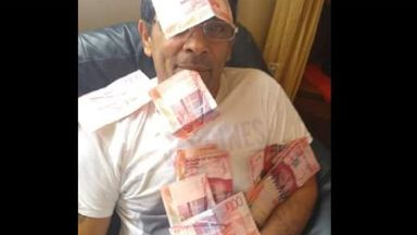 Vojtech Gombar posted images on Facebook with piles of cash.