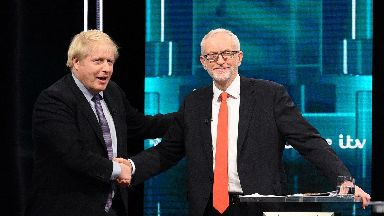 Leaders: Johnson and Corbyn shake hands during election showpiece.