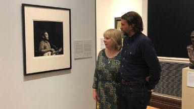 Family: Marion and Grant Hutchison admire the portrait.