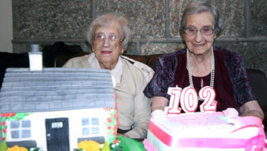 Twins: Celebrating their 102nd birthday.