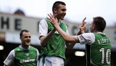 Dirty Dozen: Hibs striker Nish celebrates with Riordan