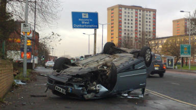 Car overturns after driver takes ill