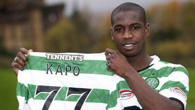 That's my name: Kapo proudly holds the Celtic shirt