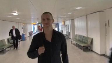 Final offer: Kenny Miller bumped into a spirited Hibernian fan en-route to Turkey.