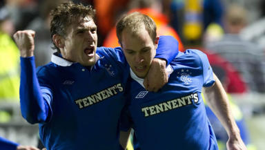 Steven Whittaker celebrates with Nikica Jelavic after scoring his second penalty at Tannadice.