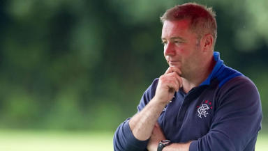 Ally McCoist is in Germany with his Rangers squad but is working hard to bring new recruits into the club.