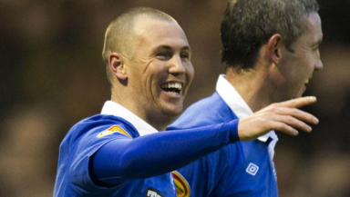 Kenny Miller is said to be on his way to Cardiff City for a medical, after Bursaspor accepted their transfer offer.