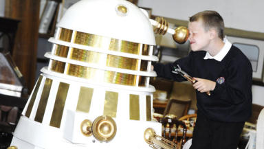 Dr Who fan Josh Henderson gets close to the Dalek.