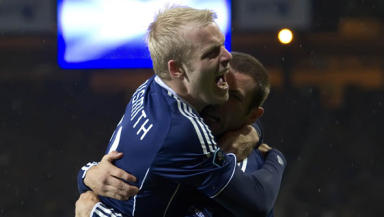 Steven Naismith (left) celebrates after scoring Scotland's decisive goal in their win over Lithuania.