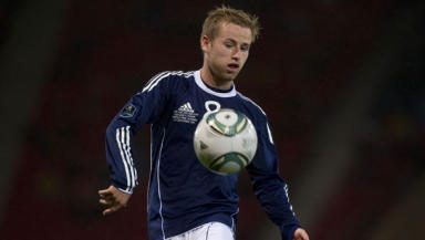 Barry Bannan earned his seventh cap for Scotland against Lithuania in what was his competitive debut for his country.
