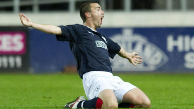 Mark Millar's free-kick consigned Rangers to a shock League Cup exit at the hands of Falkirk.