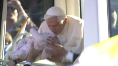 Open mass: this image of Pope Benedict XVI kissing a baby at Bellahouston Park is one which defined the day