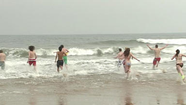 Beach run: Students from RGU take a dip for charity