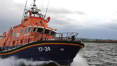 Rescue: Lifeboat crews assist cargo ship.