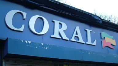 Coral: Bookmakers was raided by two men.