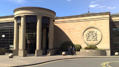 Attack: Gang admit chasing disabled man at High Court in Glasgow.