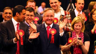 Labour Glasgow City Council leader Gordon Matheson centre celebrates a candidates victory at the Glasgow local elections at the SECC