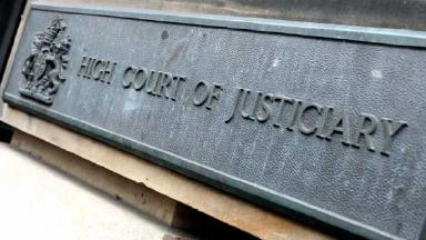 Sign outside the High Court of Justiciary in Edinburgh. Quality image.