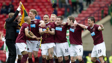 Hearts players celebrate cup win at Hampden