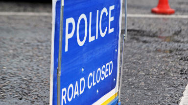 Quality close up of police road closed sign in Edinburgh.