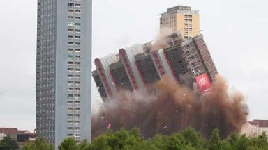 Red Road: The first tower has come down after decades of dominating the Glasgow skyline. 10 June 2012. Quality image.