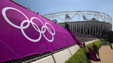 Going for gold: London 2012 banners being put up outside the Olympic stadium