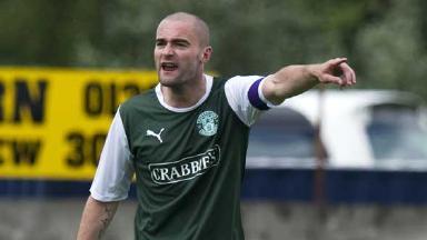 James McPake in action for Hibernian,