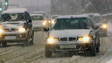Caution: Snow and ice could cause problems for motorists on the road.