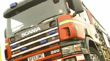 Fire crews battle house fire