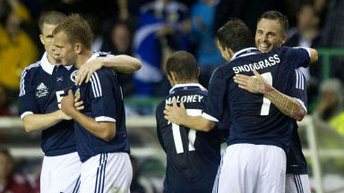 Scotland players celebrate after their 3-1 win over Australia.