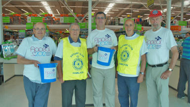 Charity bagpack: Members of the Rotary Club of Hamilton fundraise for the STV Appeal.