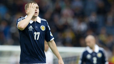 James Forrest appears dismayed with a draw against Serbia.