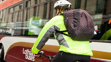 Cyclist and a bus