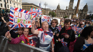Olympic parade: Fans descend on George Square  to celebrate Scotland's Olympic heroes.