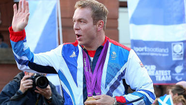 Sir Chris Hoy waves to supporters at the Glasgow Olympic parade.