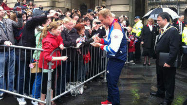 Britain's greatest Olympian Chris Hoy signs autographs for fans at Edinburgh Olympic Parade.