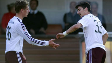 Callum Paterson (right) is congratulated by team mate Marius Zaliukas after scoring to give Hearts a three-goal lead.