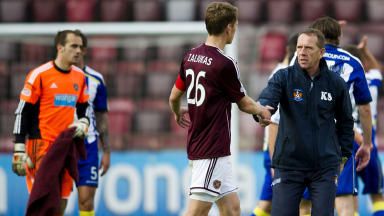 Kilmarnock manager Kenny Shiels (right) shakes hands with Hearts captain Marius Zaliukas at full time