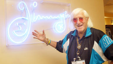 Sir Jimmy Savile at Stoke Mandeville Hospital in Buckinghamshire where he was a volunteer porter.