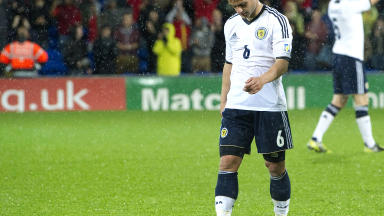 Shaun Maloney looks deflated after Scotland lose to Wales.