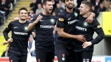 Gary Hooper celebrates with his Celtic teammates after scoring against St Mirren.