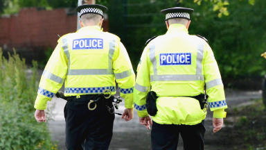 Robbery: Pensioner threatened at her front door by two men.