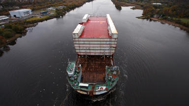11,300-tonne aft section of hull for HMS Queen Elizabeth being taken by barge from Govan, Glasgow, to Rosyth on the Firth of Forth on 4 November 2012. Quality image.